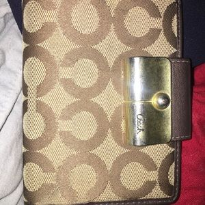 Medium Brown Coach Wallet with Gold Accents.